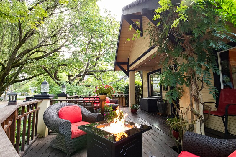 Spacious and Comfortable Front Porch with Firepit