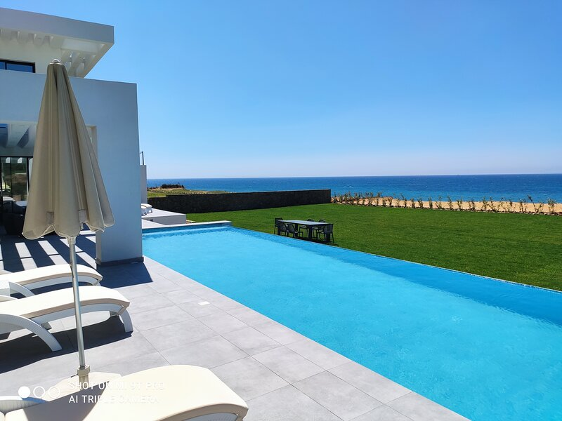 LUXURY SEAFRONT VILLA - PRIVATE INFINITY POOL - VILLA  AFRODITI, vacation rental in Corfu