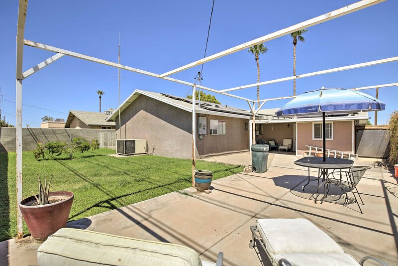 This vacation rental features an outdoor living space with an enclosed yard!