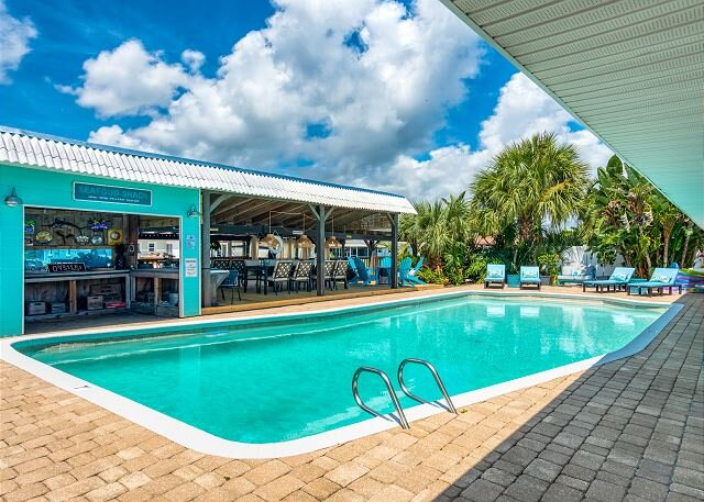 Canal-Front Dream w/ Saltwater Pool, Dock & Arcade Room – 3 Blocks to Beach!, location de vacances à Flagler Beach