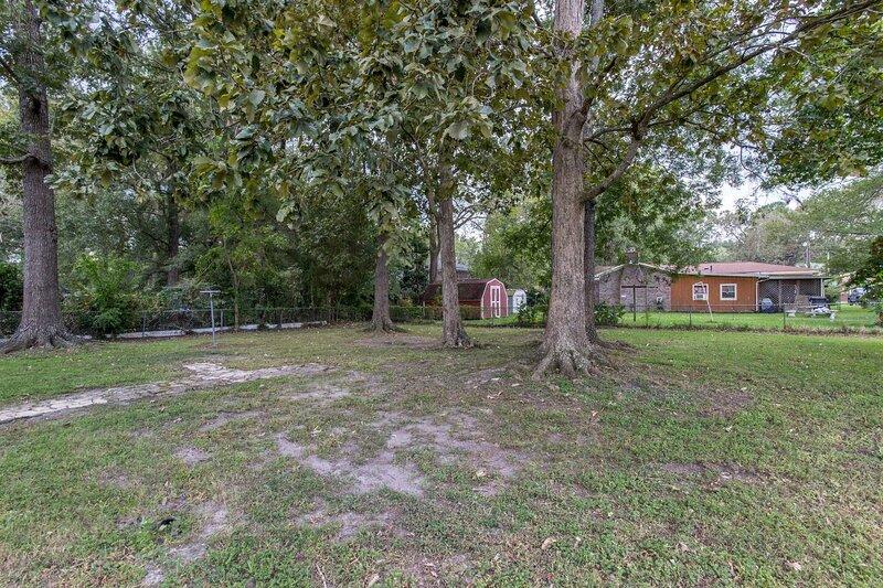 Large back yard with hammock and horseshoes