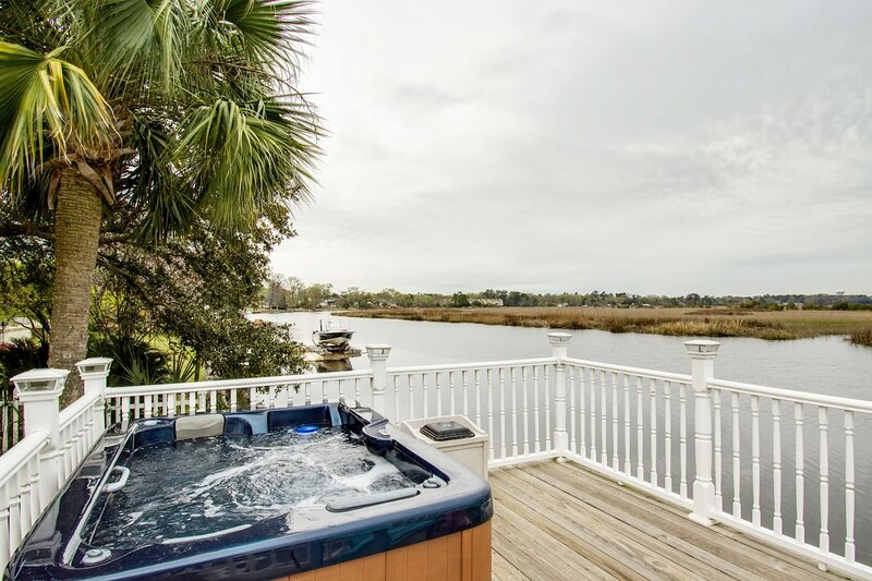 Relax in the Jacuzzi Hot Tub overlooking the river and private dock below
