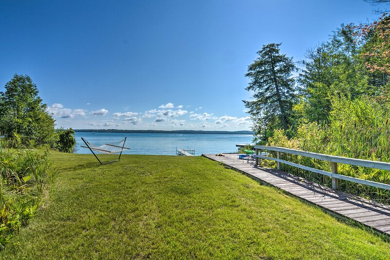 Torch Lake Home w/ 116 feet of Blue Water Access!, holiday rental in Alden