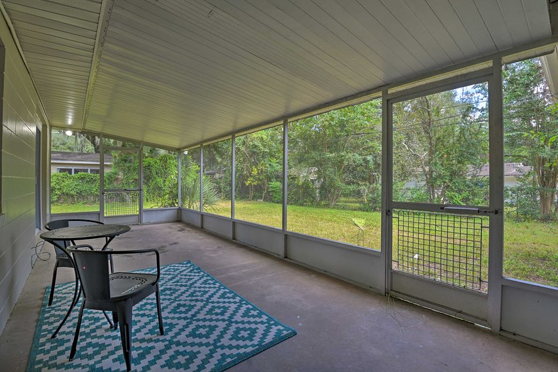 Enjoy your morning coffee on the vacation rental's screened porch.