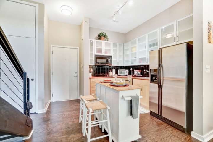 Cozy kitchen with etched glass cabinets and a new Bosch dishwasher.