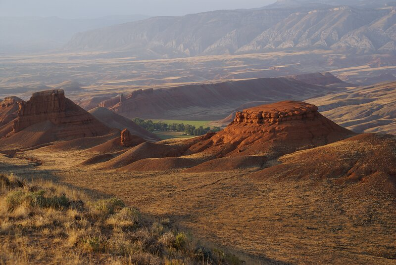 View from the surrounding public lands on The Trapper Creek Ranch surrounded by green pastures.