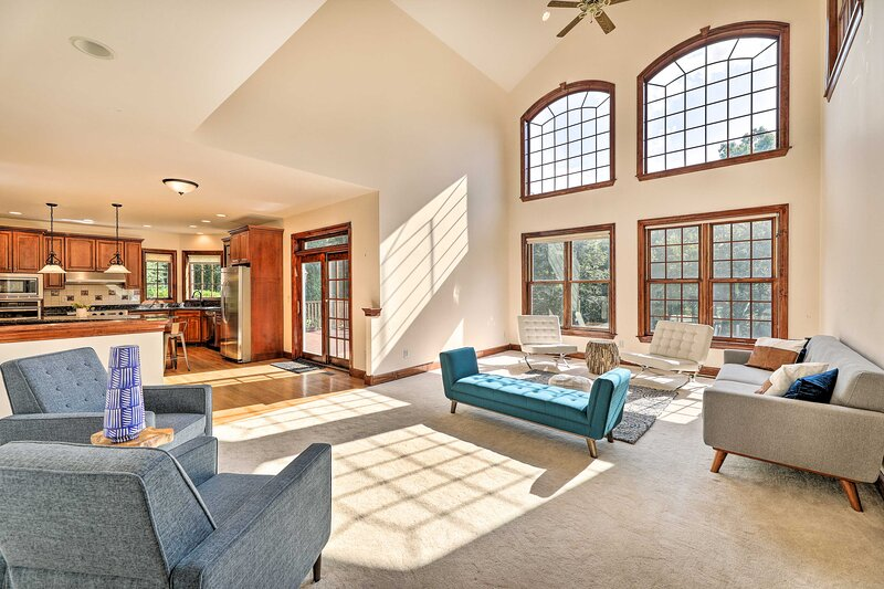 The interior boasts high ceilings, large windows & 5,500 sq ft of living space.