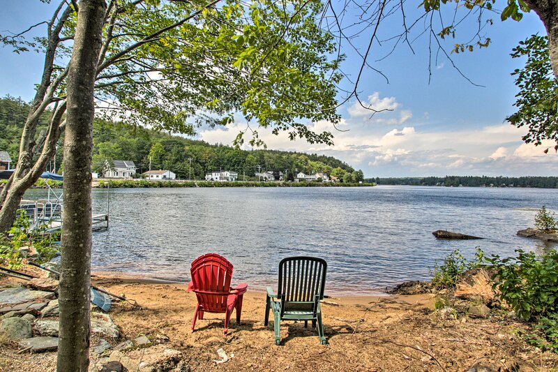 Spend days lounging on the property's private sandy shoreline.