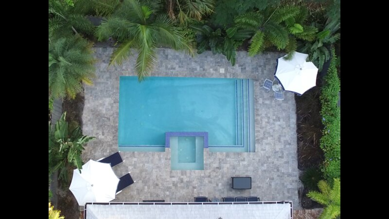 Completely private, peaceful pool area surrounded by tropical plants and flowering vines.