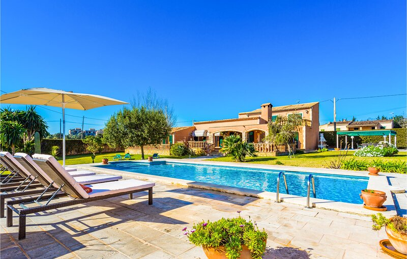 Awesome home in Port Verd with Outdoor swimming pool, WiFi and 5 Bedrooms (EMA70, holiday rental in Costa De Los Pinos