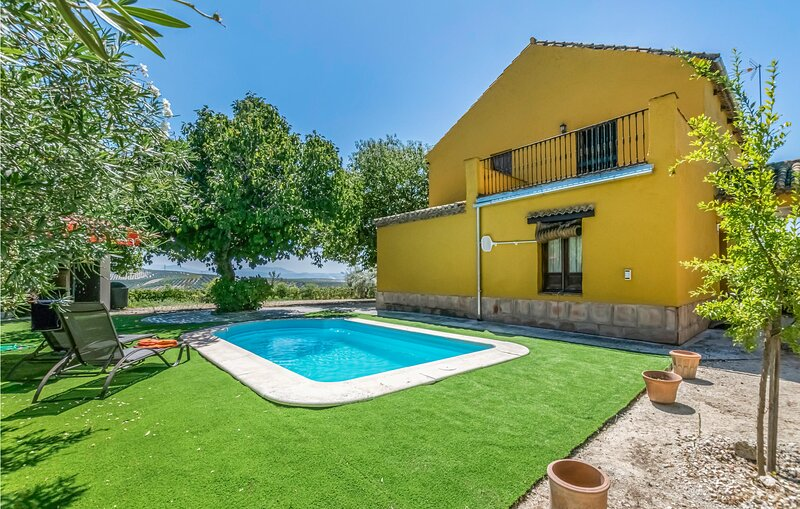 Nice home in Montilla with Outdoor swimming pool and 3 Bedrooms (EAC501), holiday rental in Baena