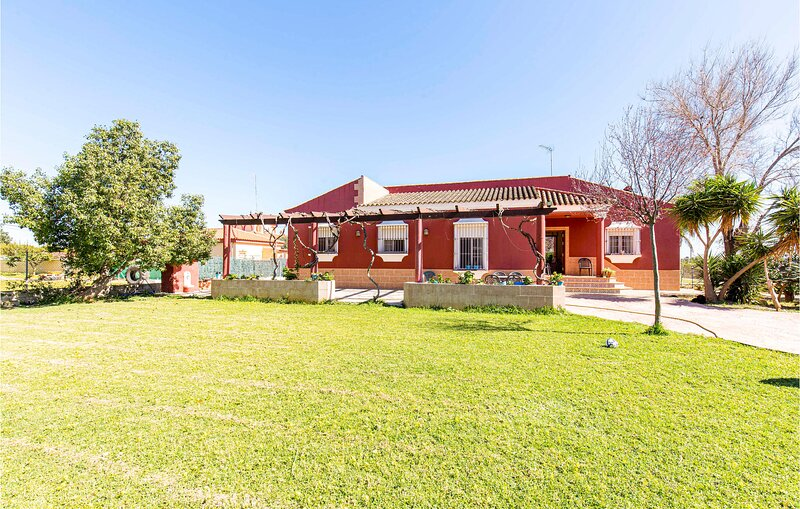 Stunning home in Utrera with Outdoor swimming pool, WiFi and 4 Bedrooms (EAC494), holiday rental in Los Palacios y Villafranca