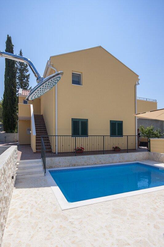 Property building, entrance, outdoor shower, pool