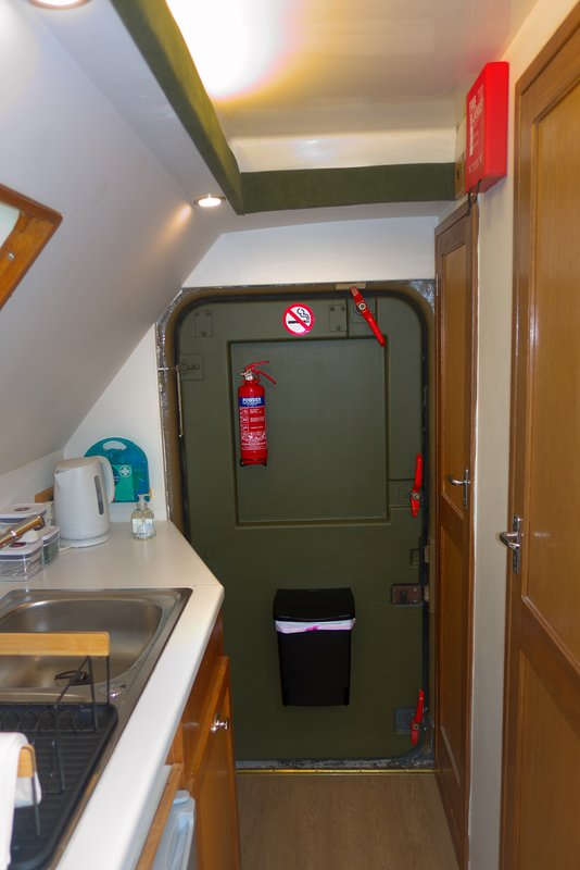 Chunky military door - keeps the riff-raff out!