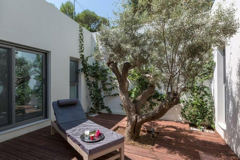 An olive tree together with bugainvilleas are in the centre surrounded by the bedrooms on either side. A stunning piece of design