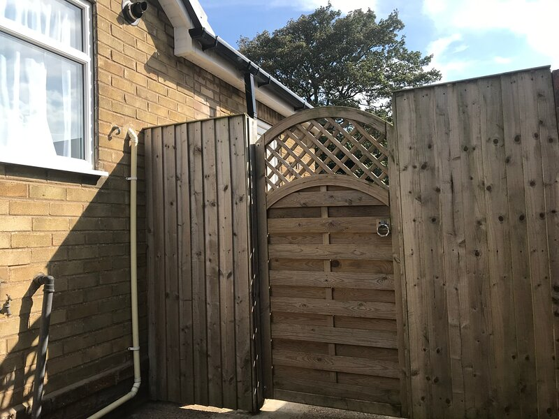 Side gate secures the back of the property. Back door can be left open for children and pets to play