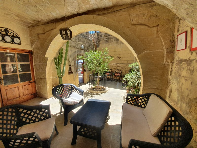 Shaded area leading to courtyard. A favourite spot with guests.