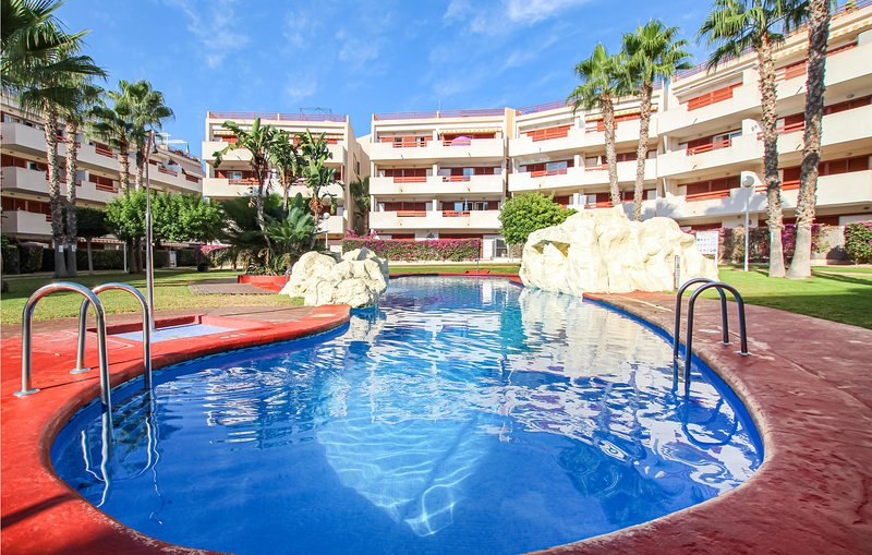 Amazing apartment in Nucleo Orihuela-Costa with Outdoor swimming pool, WiFi and, vacation rental in Punta Prima