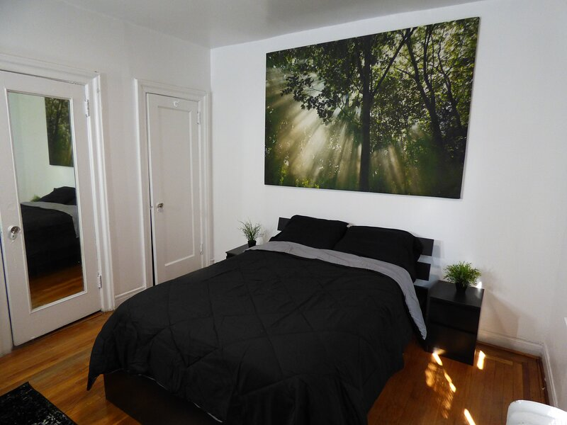 """Bedroom #1: Full sized bed with two bed-side tables, 5' desk, two closets, 35"""" smart HDTV."""