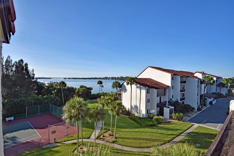 View of bay and tennis courts from your deck