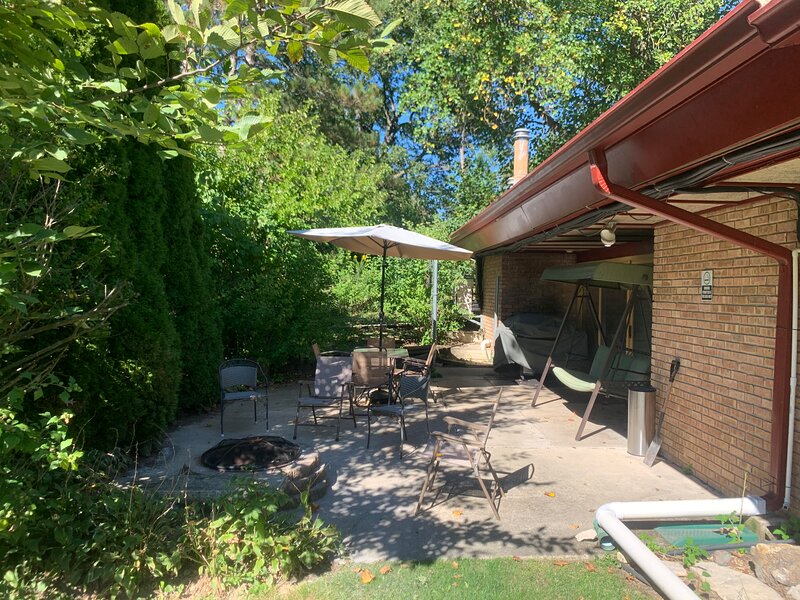 Back patio has 6 burner propane grill and plenty of seating.