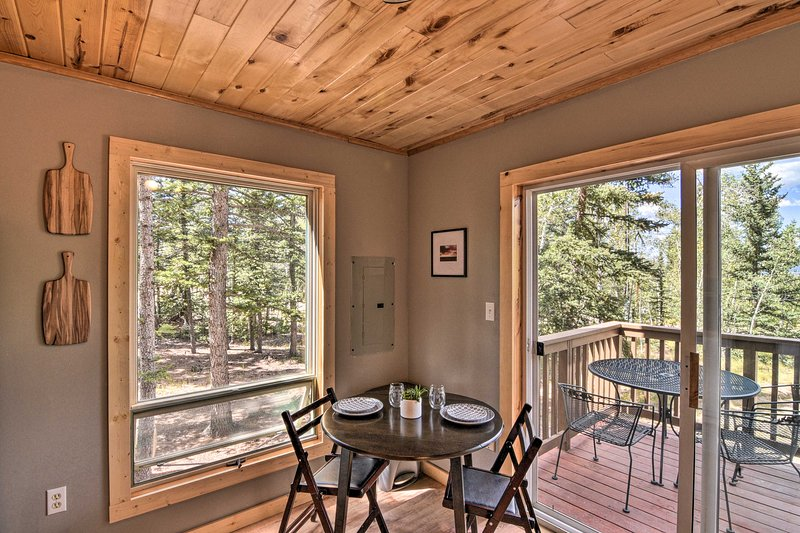 The cabin is located in a quiet wooded area, perfect for a romantic getaway.