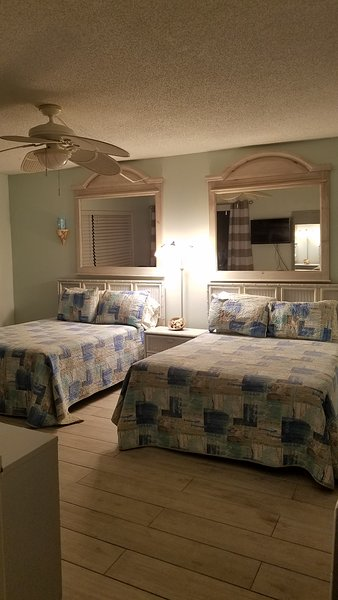 2 full size beds with balcony & full bath, flat screen tv and dvd player