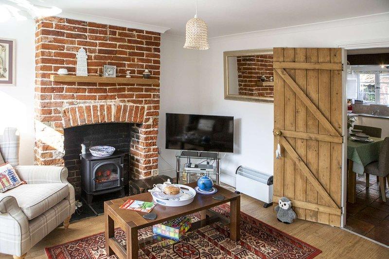 Cosy coastal cottage in Norfolk with spa bath., location de vacances à Martham