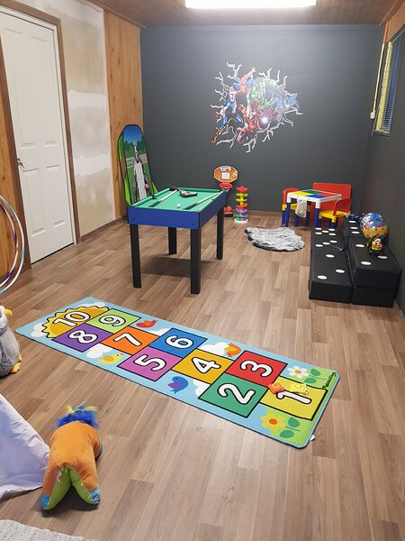 Kids playroom with toys, games, scooters, hoola hoops to have some fun with.