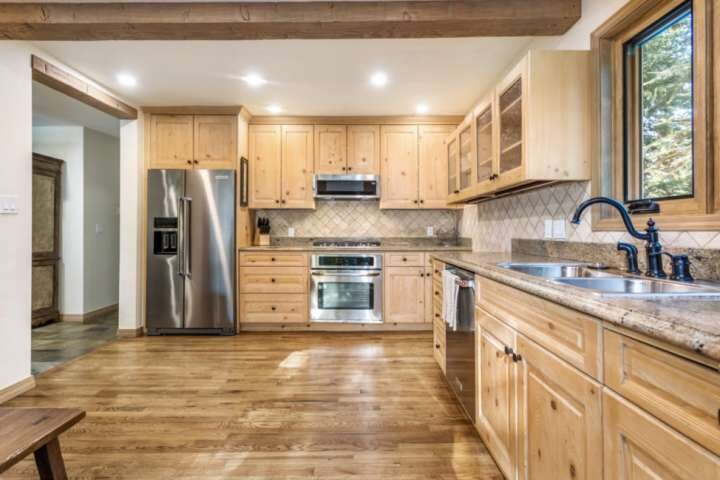 Gorgeous granite countertops provide plenty of workspace for the chef.