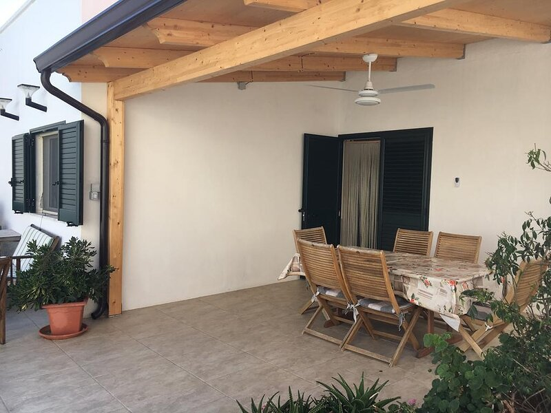 Gazebo area with ceiling fan and light, alfresco eating anytime.