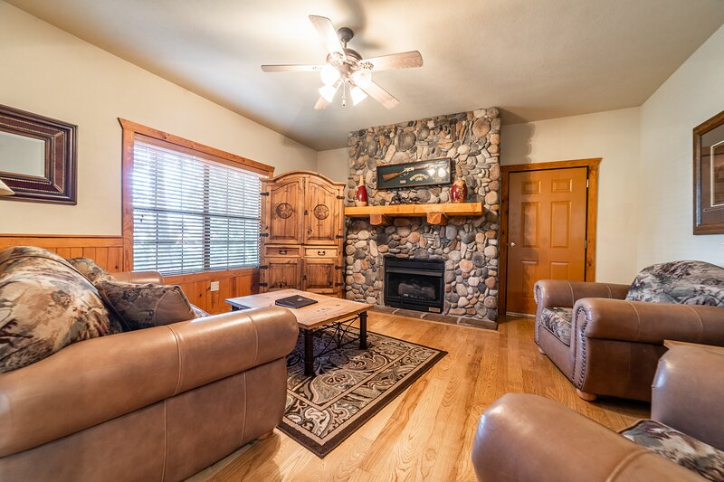 The Living Room features a Gas Fireplace, Cable TV/DVD, and a Sofa Bed