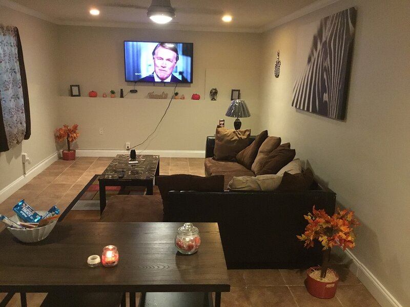 Huge living room space for family and friends with complimentary snacks and candy