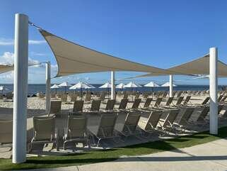 Full service beach/oceanfront. Relax and read under the sails.
