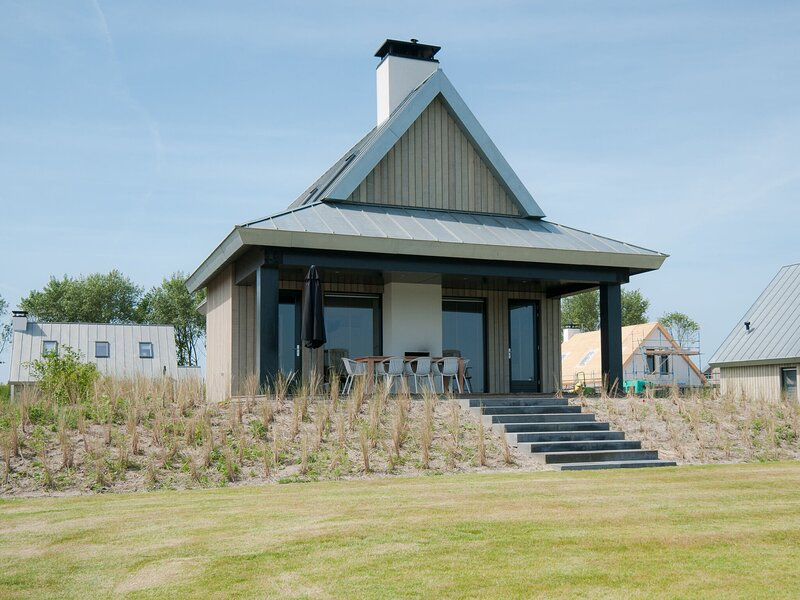 Modern design lodge directly at the water, in national park, vacation rental in Huijbergen