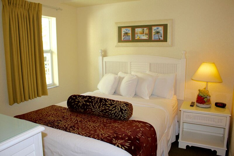 Spacious master-bedroom with a King bed and flat screen TV