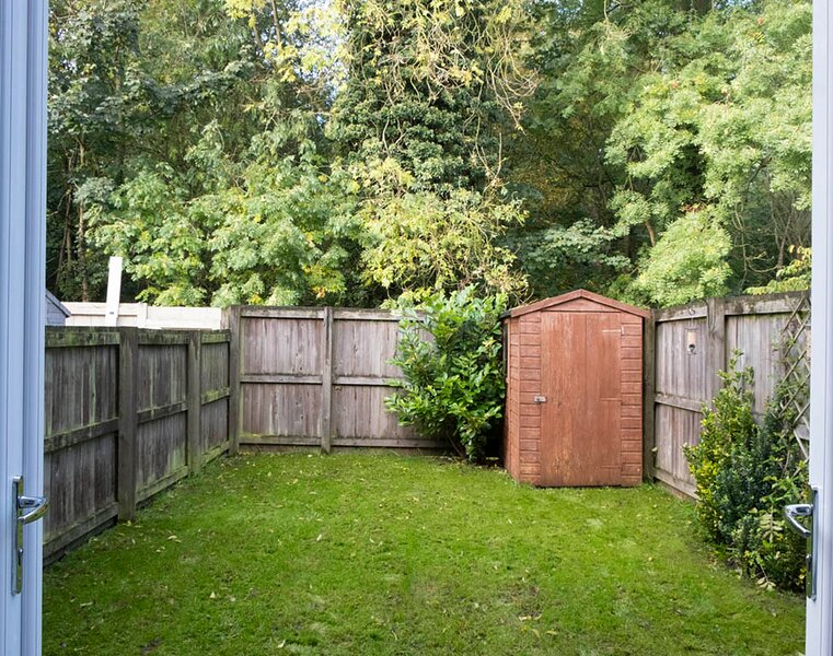 Private rear garden backing on to woodland.