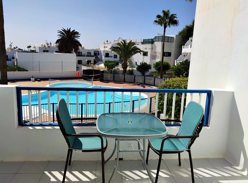 The balcony overlooks the communal pool and has sun for much of the day