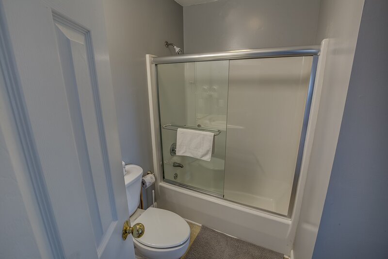 Ground-Level Hall Bathroom shares access to Queen Bedroom