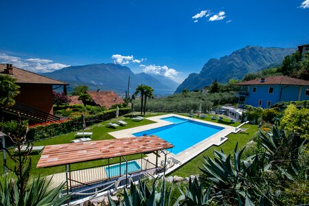 The swimming pool with a wonderful view on the mountains and lake