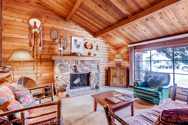 Large open living room made cozy with wood burning fireplace