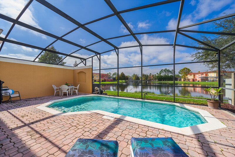 Orchid Oasis-4BR Pool, LakeView, Terra Verde RESORT with Heated Pool, Tiki Bar, holiday rental in Kissimmee