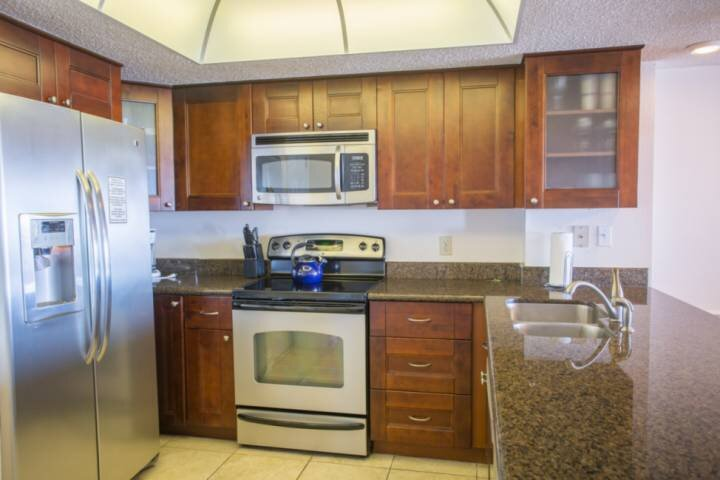 Granite and Stainless Steel in Fully Equipped Kitchen