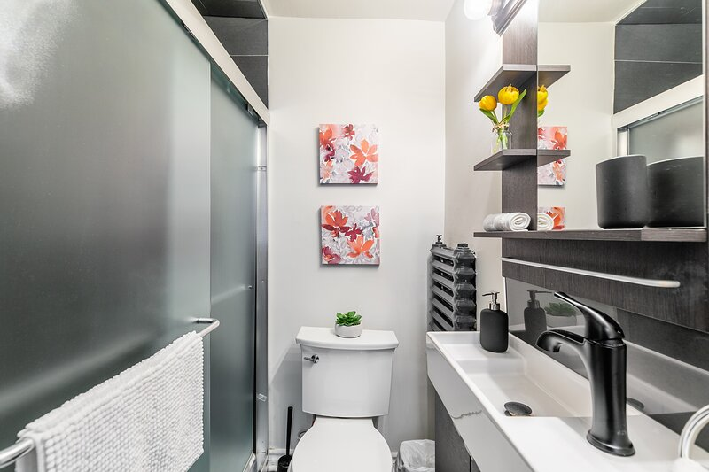 The bathroom is bright and modern.
