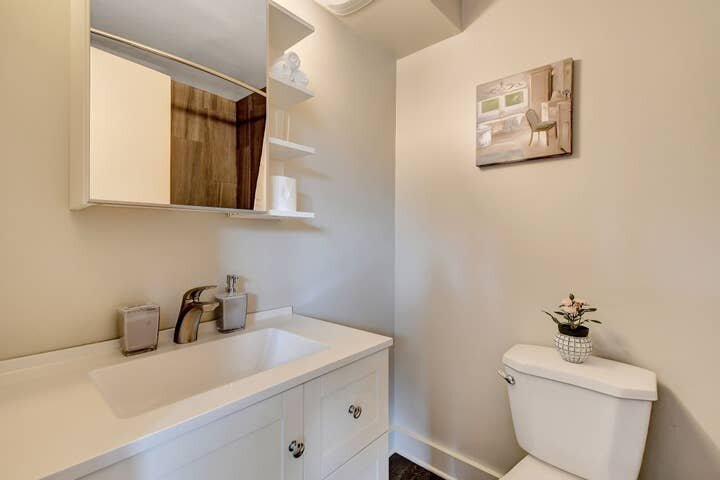 The bathroom is modern and spacious.
