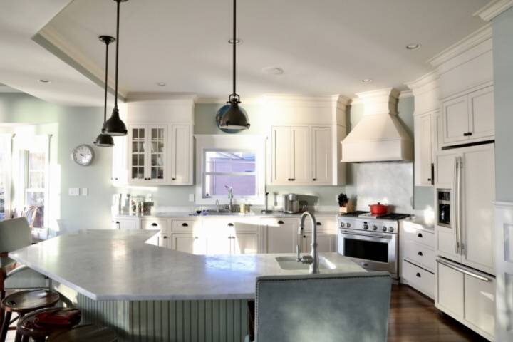 Bright beautiful gourmet kitchen overlooking dining and living rooms
