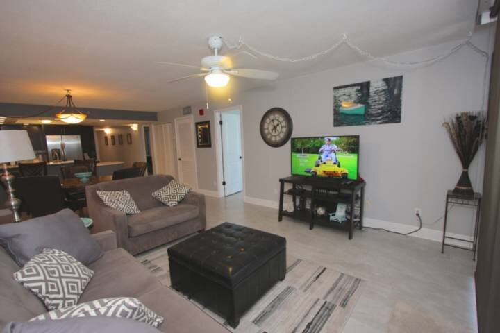 Living room with flat screen TV and convertible sofa.