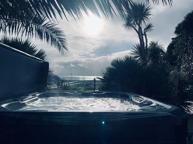 Newly installed 6 person hot tub with views across Torbay towards Brixham