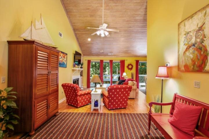 Foyer opens to family room with comfortable seating