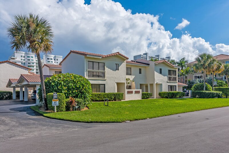 Private entrance in quiet residential neighborhood.  Carports and parking steps from you door.